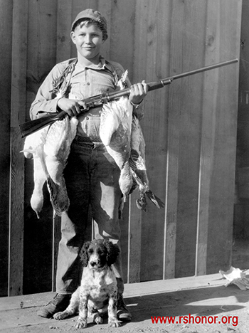 Fenslers grew up an active youth in the Tule Lake, California, area, as in this image, as a young hunter with his dog.